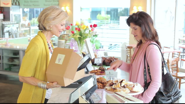 MS Customer selecting baked goods in bakery cafe / Los Angeles, California, United States