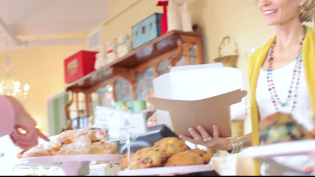 LA Customer selecting baked goods to buy in bakery cafe / Los Angeles, California, United States