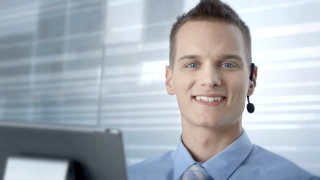 hd: customer service advisor smiling at camera - bluetooth stock videos & royalty-free footage