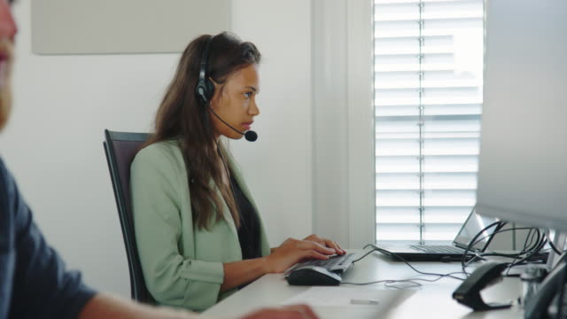customer service representative working at her desk - financial advisor stock videos & royalty-free footage