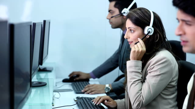 customer service representative working on computer in the office, delhi, india - indian ethnicity stock videos & royalty-free footage