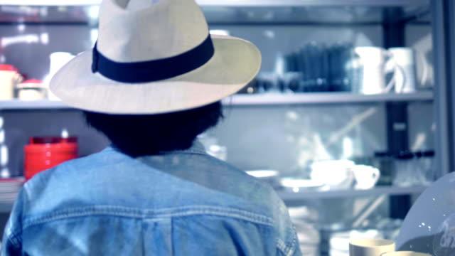 customer shopping craft ceramics - kitchenware shop stock videos & royalty-free footage