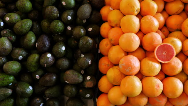 ms cu customer shopping for avocados in produce market - vegetable stock videos & royalty-free footage