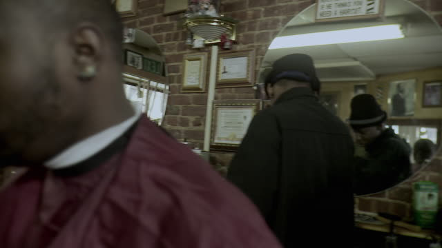 cu pan customer sitting at barbershop, brooklyn, new york city, new york state, usa - see other clips from this shoot 1437 stock videos and b-roll footage