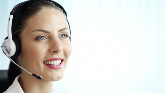 customer support operator smiling, speaking, at office - headset stock videos & royalty-free footage