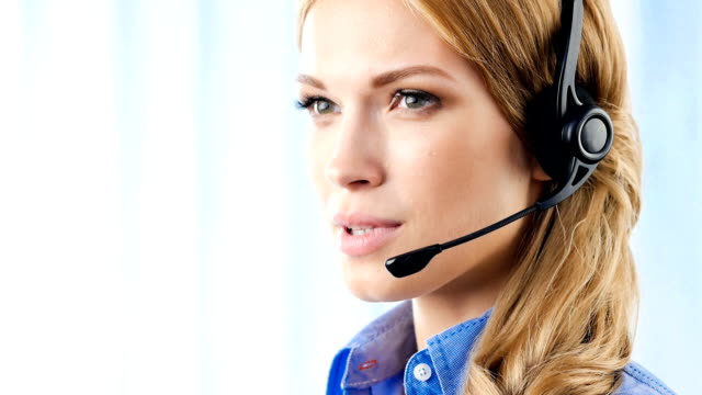 customer support operator smiling, speaking, looking at camera, in office - customer service representative stock videos & royalty-free footage
