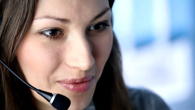 Customer support phone operator at workplace