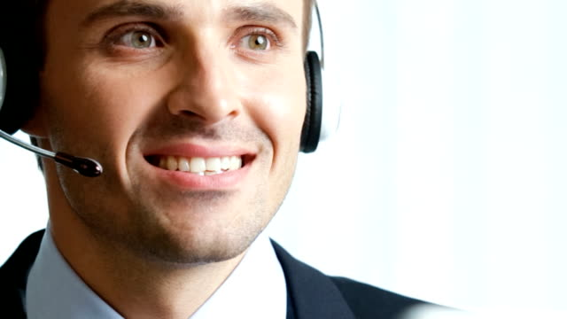 HD: Customer support phone operator at workplace, working