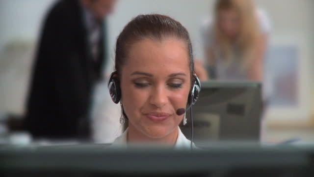 hd dolly: customer support - telecommunications worker stock videos & royalty-free footage