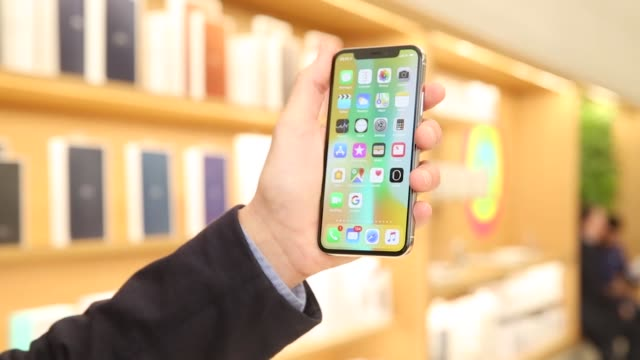A customer tests the face recognition function of an iPhone X smartphone at the Apple Inc store on Regent Street in London UK on Friday Nov 3...