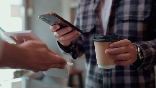 customer use smart phone pay contactless. - giving stock videos & royalty-free footage