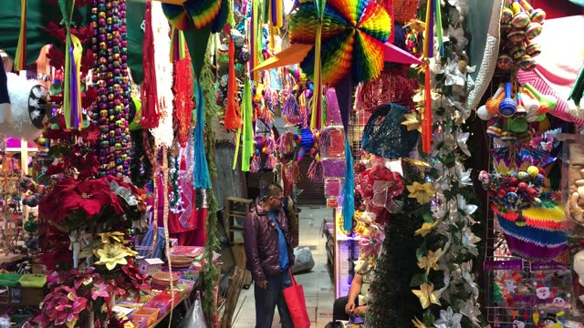 customer waits in the middle of colorful pinatas on the picturesque coyoacan market on december 12, 2020 in mexico city, mexico. authorities... - papier stock videos & royalty-free footage