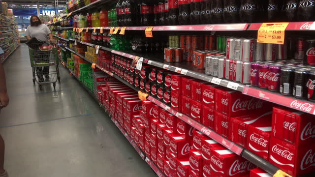 customer wearing face mask shop in a grocery, a shelf filled with coca cola drinks in atlanta, georgia on may 31, 2021. north carolina surry county... - large group of objects stock videos & royalty-free footage
