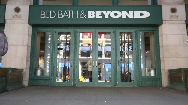 customers and commuters walk past the entrance to a bed bath & beyond store location in manhattan, new york, us on april 6th, 2015 shots: steady,... - double bed stock videos & royalty-free footage