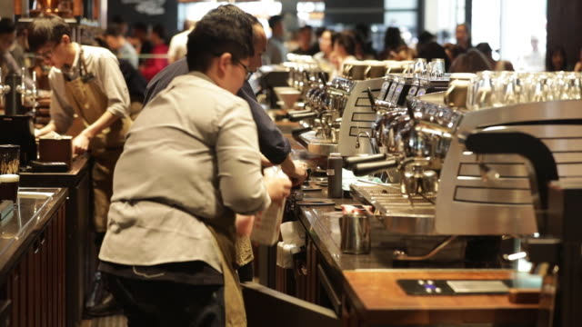 vídeos de stock, filmes e b-roll de customers and employees at the starbucks reserve roastery shanghai in shanghai china on friday april 11 2018 - starbucks