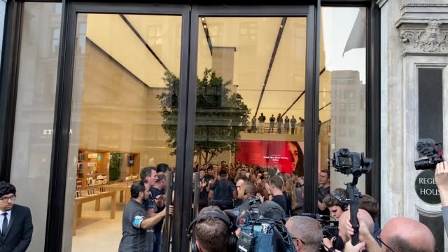 customers are applauded as they arrive to collect their preorders for new apple products at the tech giant's flagship store in regent street central... - smart phone stock videos & royalty-free footage