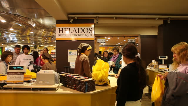 Customers are buying Chocolate products in the sales room which connects directly to the chocolate factory 'Del Turista' in Bariloche in Patagonia