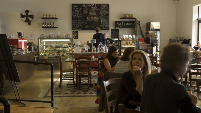 customers at a cafe in tauranga, new zealand come and go in a time lapse. - café stock-videos und b-roll-filmmaterial