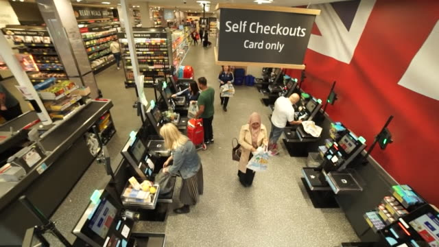 customers at aldi supermarket checkout in london - paying stock videos & royalty-free footage