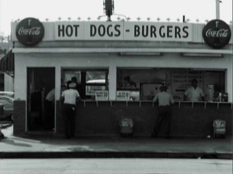 montage customers at roadside hot dog stand / los angeles, california, united states - hot dog stock videos & royalty-free footage