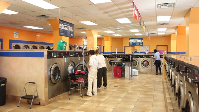 customers at super suds laundromat in reading pennsylvania on december 12 2011 customers folding clothes - launderette stock videos & royalty-free footage