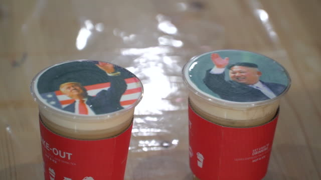 customers at the caface cafe in seoul can get pictures printed onto coffee foam the venue uses a printer to apply ink to the cold froth 00 to 0006... - froth art stock videos and b-roll footage