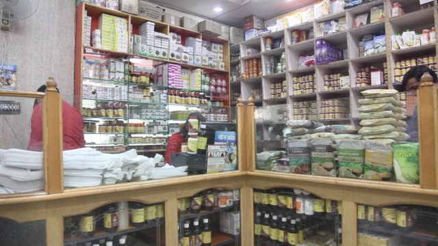 Customers browse at a Patanjali Ayurved Ltd store in New Delhi India on Saturday Nov 19 Patanjali Ayurved Ltd logo is displayed on products in one of...