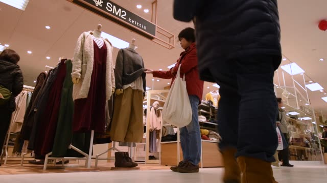 Customers browse children's winter clothes at an Ito Yokado Co Ario shopping center owned by Seven i HOldings Co during its reopening in Tokyo Japan...