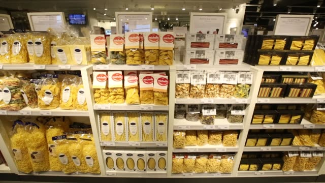 vidéos et rushes de customers browse confectionary products for sale inside the new eataly food store operated by eataly net srl at the kievsky shopping mall in moscow... - for sale petite phrase