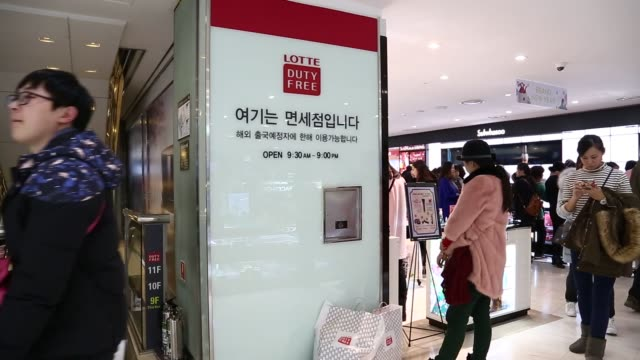 stockvideo's en b-roll-footage met customers browse cosmetic products at a hotel lotte co duty free store in seoul south korea on thursday feb 4 2016 shots pan right of many people... - seoel