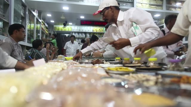 Customers browse foods on display at a store at the Vashi Agricultural Produce Market Committee wholesale market in Mumbai India on Monday Aug 12 A...