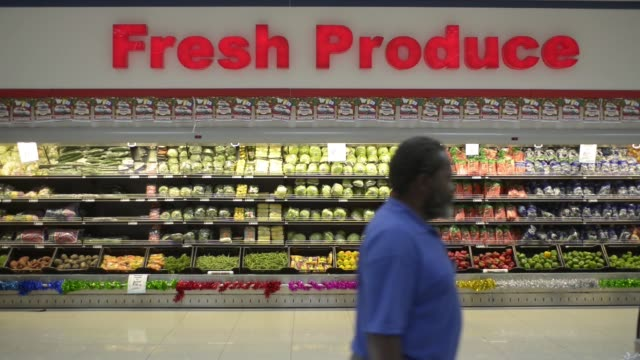 customers browse fruit and vegetables inside a choppies supermarket operated by choppies enterprises ltd in rustenburg south africa on tuesday nov 17... - 生鮮食品コーナー点の映像素材/bロール
