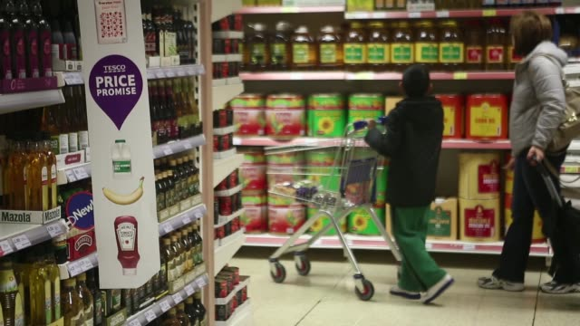 customers browse goods displayed for sale on aisles inside a tesco metro store operated by tesco plc in london uk on wednesday oct 16 bottles of... - for sale englischer satz stock-videos und b-roll-filmmaterial