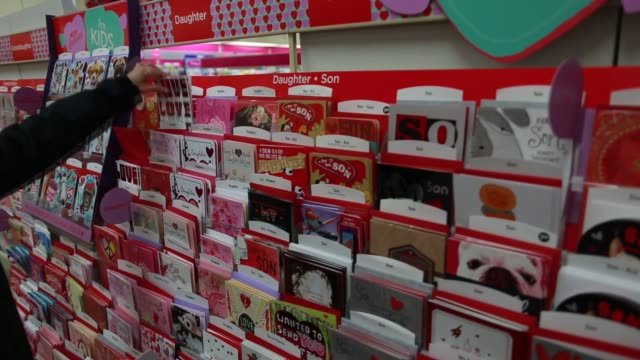 vídeos de stock, filmes e b-roll de customers browse greeting cards at a hallmark gold crown store in knoxville tennessee us on tuesday feb 10 wide shots and close ups of valentines day... - dia dos namorados
