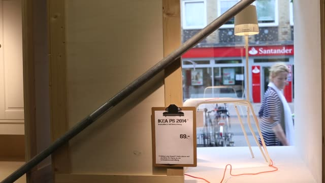 customers browse homeware and furniture inside an ikea ab high street store in hamburg germany a customer looks at a lamp as it stands illuminated in... - homeware stock videos and b-roll footage