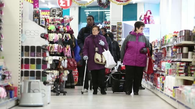 customers browse the health and beauty aisle inside a poundland discount store operated by poundland holdings ltd in birmingham uk on friday dec 20... - for sale englischer satz stock-videos und b-roll-filmmaterial