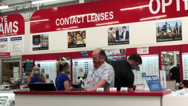 customers browsing at costco's instore contact lenses kiosk in georgia united states on august 26 2020 - eyesight stock videos & royalty-free footage