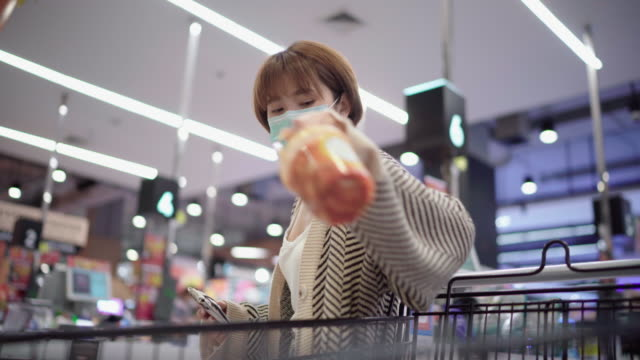 customers buying food and staples from a cashier and paying at the till. supermarket - cashier stock videos & royalty-free footage