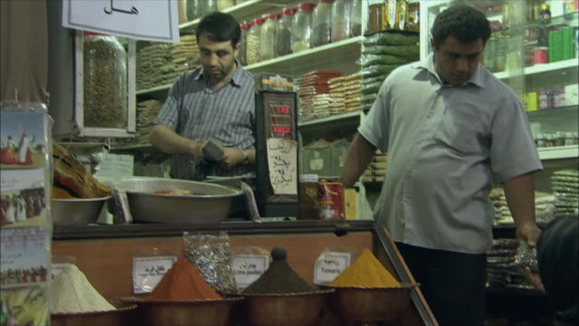 MS TD TU Customers buying food at market stall, Shiraz, Iran