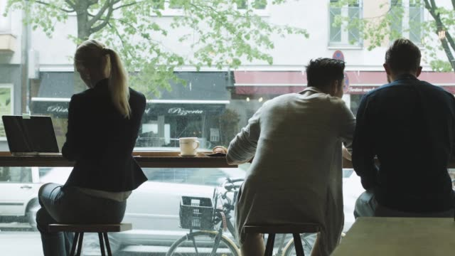 customers by window in city cafe - cafe culture stock videos & royalty-free footage