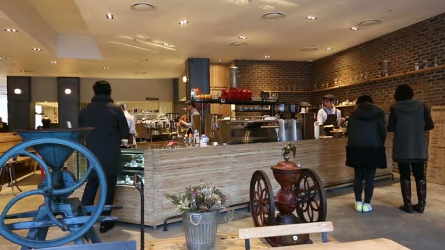 customers chat and drink coffee at the terarosa coffee shop in seoul, south korea, on tuesday, feb. 4 pan interior of coffee shop, customers are... - coffee drink stock videos & royalty-free footage