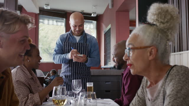 customers chatting in restaurant - sitting stock videos & royalty-free footage