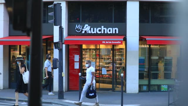 customers come in and out at an auchan brand supermarket in the 15th arrondissement on september 9, 2020 in paris, france. the retailer established... - employment issues stock videos & royalty-free footage