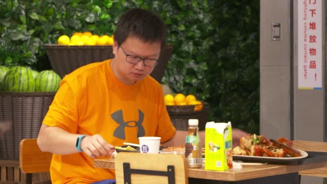 customers dine at a restaurant inside an alibaba group holding ltd hema store in shanghai china on tuesday sept 12 2017 - ware stock-videos und b-roll-filmmaterial