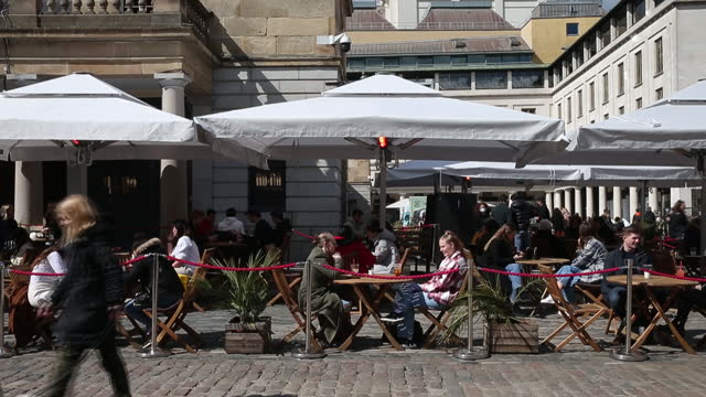 customers dine at tables in outside restaurants in covent garden, after england eases lockdown again, in london, england, u.k., on monday, april 12,... - social distancing stock videos & royalty-free footage