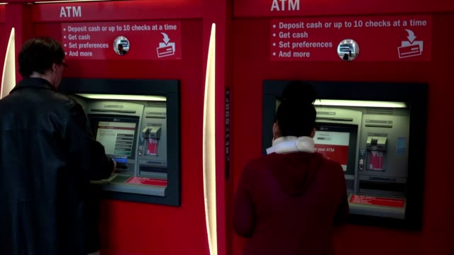 customers doing business at atm machine in new york city - bank of america stock videos & royalty-free footage