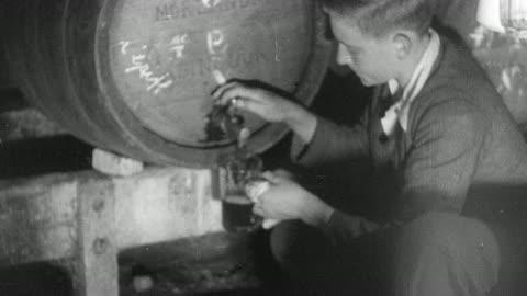 1937 b/w montage customers drinking in a pub - 1937 bildbanksvideor och videomaterial från bakom kulisserna