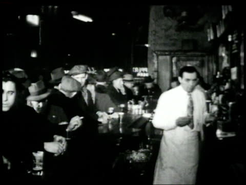 1946 montage customers drinking in bar / new york, new york, united states - moving image stock videos & royalty-free footage