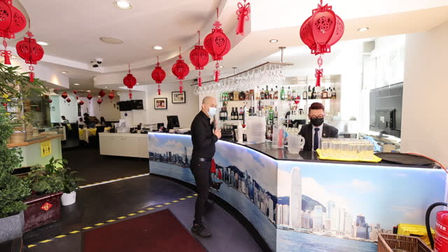 customers enjoy restaurants and pubs reopened after coviid-19 lockdown in chinatown, london, uk, on monday, may 17, 2021. - new normal concept stock videos & royalty-free footage