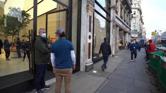 customers enter the apple store after queuing for the latest iphone on october 23, 2020 in london, england. apple's latest 5g smartphones go on sale... - wireless technology stock videos & royalty-free footage